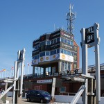 The TT Control Tower in among the competitors Quick Filler Stands TT 2012 - © Peter Killey