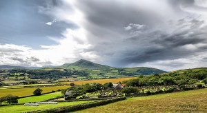 Overlooking Maughold Church and North Barrule Mountain - © Peter Killey